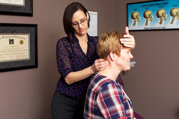 West Des Moines Chiropractor Dr. Laurel Griffin checks alignment